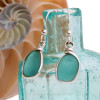 The left earring is the original and the right is the new custom made from our sea glass from Hawaii.