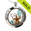 Beautiful piece aqua sea glass piece combined with a real starfish. Finished with a vivid brilliant cut aquamarine gem in this stainless steel twist top locket. SOLD - Sorry this Sea Glass Locket is NO LONGER AVAILABLE!