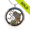 A Beautiful piece of Green Olive Genuine sea glass combined with a real starfish, seafan and a solid sterling Maine State Charm. Finished with real beach sand  in this JUMBO 35MM stainless steel locket necklace.
