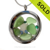 Beautiful pieces of perfect Genuine Green Sea Glass combined with a real baby Sandollar. Finished with crystal Emerald and Carolina Blue gems in this Jumbo Twist Top Locket . SOLD - Sorry this Sea Glass Locket is NO LONGER AVAILABLE!