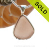 This perfect triangle of peach sea glass is set in a mixed metal gold and sterling silver Deluxe Wire Bezel setting. Very Versatile and elegant. CLASSIC! SOLD - Sorry this Rare Sea Glass Pendant is NO LONGER AVAILABLE!