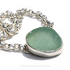 A Perfect piece of Seafoam Green sea glass from set in an artisan fine and sterling silver backed bezel necklace. Presented on a 6.4 MM hammered Rolo Solid Sterling Chain.