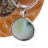 The B side is partially opalized and partially translucent. This sea glass is highly sought after.