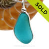 This is a beautiful Electric Bright Blue Aqua Sea Glass set in our Original Wire Bezel© pendant setting in Sterling Silver . SOLD - Sorry this  Rare Sea Glass Necklace is NO LONGER AVAILABLE!