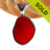 This is a very LARGE Genuine Ruby Red Sea Glass Pendant in our deluxe Wire Bezel setting.