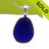 A stunning thick piece of genuine UNALTERED sea glass in an elegant setting.A perfect and LARGE piece of vivid Midnight Blue sea glass from the UK in our In Deluxe Sterling Wire Bezel© Setting that leaves the glass just the way it was found on the beach.   SOLD - Sorry this Rare Sea Glass Pendant is NO LONGER AVAILABLE!