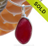 A once in a lifetime piece of large deep  red sea glass is set in our Original Wire Bezel© pendant setting. SOLD - Sorry this Rare Sea Glass Pendant is NO LONGER AVAILABLE!