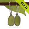 Genuine thick and vivid Peridot Green English Sea Glass Earrings in our Original Wire Bezel is Solid Sterling Silver.