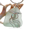A stunning TOP QUALITY and LARGE Seafoam Green Genuine Sea Glass Pendant set in our Signature Waves© setting in Sterling Silver. This perfect light sea green natural beach found sea glass in our WAVES sterling setting that maximizes the bling of silver
