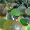 Green sea glass comes in many shades from a common kelly green to rarer olive and lime greens. Most green sea glass originated as bottles that were commercially made.