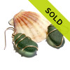 A spiral wrapped goldfilled sea glass earring using beach found UNALTERED sea glass.
