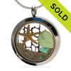 Genuine peridot green Sea Glass Locket with a small REAL starfish, a tiny bit of vintage seafan and real beach sand in this stainless steel locket. Finished with a  vivid peridot crystal gems for a bit of beachy bling. SOLD - Sorry this Sea Glass Locket is NO LONGER AVAILABLE!