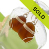 Brown Sea Glass Earrings  Though we specialize in Rare Genuine Sea Glass this is a nice pair of amber brown sea glass earrings in gold. A perfect match of sea glass from Puerto Rico, set in gold!