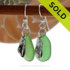 A simple pair of green Genuine Sea Glass Earrings with sterling lbeachy Flip Flop charms in a lightweight simple setting.