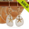Beautiful Pure White Sea Glass Earrings with 14K Goldfilled Starfish charms naturally tumble by tide and time.