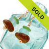 Green and brown sea glass pieces combined with aqua glass beads in a 14K Goldfilled earring. Sorry this sea glass jewelry item has been sold!