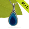 A Lovely Petite Mixed Aqua and Blue Seaham multi sea glass set in Sold Sterling Silver Deluxe Wire Bezel© pendant setting. Originating as end of day art glass tossed into the sea. Glass from this region tends to be the best in the world. SOLD - Sorry this Ultra Rare Sea Glass Pendant is NO LONGER AVAILABLE!