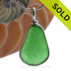 This is a P-E-R-F-E-C-T triangle of Green Sea Glass Jewelry set in our Original Wire Bezel© pendant setting in Sterling Silver . This is our signature Original Wire Bezel© design that leaves the glass UNALTERED from the way it was found on the beach. Beautiful, Classic and Versatile.