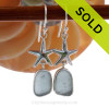 A stunning pair of baby blue sea glass earrings set in a finely crafted setting in sterling silver.