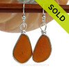 A lovely pair of long and larger Amber Brown Genuine Sea Glass Earrings in our Original Bezel Wire© setting in solid sterling silver.