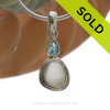 A stunning white Sea Glass Necklace set in a finely crafted setting in sterling silver finished with a beach bling brilliant Blue Topaz round gem. SOLD - Sorry this Sea Glass Necklace is NO LONGER AVAILABLE!