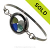 Genuine Sea Glass Locket Bracelet A single piece of seafoam green , blue and aqua sea glass a real sandollar in this one of a kind sea glass bangle bracelet!