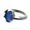 A bright vivid blue Sea Glass Ring in a low profile setting of Sterling Silver.