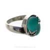 A stunning piece of Victorian Era Electric Aqua Sea glass Ring in a secure Solid Sterling leaf ring.