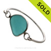 Genuine Sea Glass Bangle Bracelet in a ELECTRIC Aqua Blue set in our Deluxe Wire Bezel© sterling silver setting.
