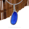 A smaller piece of Cobalt Blue Genuine Sea Glass  bottle bottom with in our signature Original Wire Bezel© pendant setting in Sterling Silver.