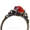A very nice piece of vivid red beach found sea glass set in a solid sterling silver scroll ring.