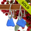 An elegant pair of natural beach found Sea Glass Earrings in a Bright Vivid Blue on Sterling Silver Deco Hooks. We meticulously sort though hundreds of pieces of beach found sea glass to find one pair that is similar in shape