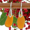 Simple longer beach found amber sea glass pieces on solid sterling silver deco hooks.