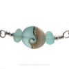 A detail of the sea glass pieces and the lovely handmade bead.