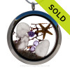 A Beautiful Slice of the Sea in this real Purple Genuine Sea Glass Locket that combines with a REAL Starfish, Seafan, and a Amethyst Gems. Finished with real beach sand for your own personal beach on the go!