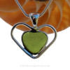A beautiful and mid rare olive Green  natural sea glass heart set in our deluxe wire bezel pendant setting!  A great gift for Valentines and your favorite wine and beach lover!