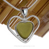 This piece features the glass and beauty of this mid rare Wine Bottle Colored Green Sea Glass and is presented on a professionally our Deluxe Wire Bezel Setting© that leaves the sea glass UNALTERED from the way it was found on the beach.