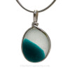 A stunning piece - This photo does not do it justice. Very 3 dimensional colors that are fused on this 150 year old sea glass piece found in Seaham England.