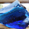 Slag or cullet glass is hunks of glass used in glass making.