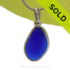 A smaller yet thick piece of Cobalt Blue English Sea Glass set in our Original Deluxe Wire Bezel© necklace pendant.