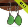 Genuine Naturally Triangles of Green Sea Glass in a Sterling Silver Earring set in our Original Wire Bezel© Setting. This setting leaves the glass UNALTERED from the way it was found on the beach. This pair is set in Solid Sterling Silver and will last a lifetime.