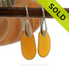 A pair of natural beach found Sea Glass Earrings in a glowing amber brown on sterling silver deco hooks. Simple and elegant, these sea glass earrings are bound to be a hit!