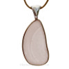 """Detail of this amazing sea glass piece. A vivid cross hatched peach or pink. The gentle """"C"""" shapes in the glass indicating a piece of TOP QUALITY sea glass."""