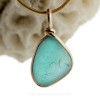 A stunning flashed aqua sea glass piece from Seaham England set in our Original Wire Bezel setting in gold!
