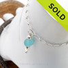 A simple but RARE Electric Aqua sea glass piece with teardrop bead on this adjustable sea glass ankle bracelet. This bracelet measures in at 10 1/4 inches if attached to the sea glass, but can be adjusted upon request. SOLD - Sorry This Sea Glass Jewelry Item is NO LONGER AVAILABLE!