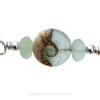 A detail of the top quality genuine sea glass pieces and the lovely handmade sea green wave bead.