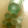 Pictured Jere, several sizes of codd marbles and one still inside the bottle.