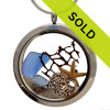 """Two pieces of genuine sea glass in blue, a bit of seafan, a real baby starfish and finished with beach sand for her own personal """"Beach On The Go""""! Sorry this sea glass jewelry selection has been sold!"""