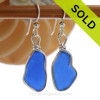 Long Irregular Shaped Cobalt Blue Sea Glass In Solid Sterling Silver Original Wire bezel© setting Our original Wire Bezel Earring setting lets all the beauty of these beauties shine! This setting does not alter the sea glass from the way it was found on the beach