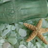 Many green sea glass pieces started out as Coke A Cola bottles tossed into the sea.